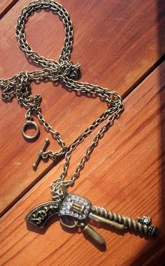 Antique bronze Gun Necklace with crystal details  by Meandtheboy, $25.00