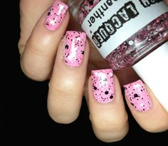 Pink, black and white splat nails.
