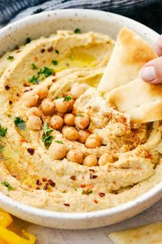 This is the BEST hummus that is fresh, flavorful, smooth and creamy plus quick and easy to make. Add this hummus for your next dip! Healthy Hummus Recipe, Homemade Hummus, Healthy Dips, Healthy Food, Food Network Recipes, Real Food Recipes, Food Processor Recipes, Cooking Recipes, Yummy Recipes
