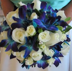 White roses and blue orchid bridal bouquet