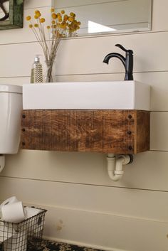 floating vanity made from reclaimed wood - Girl Meets Carpenter featured on @Remodelaholic