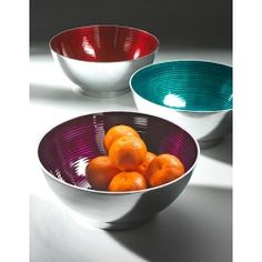 Gorgeous jewel coloured round salad bowls. Made in India under fair trade conditions. Traditionally sand cast in recycled aluminium, with a ribbed design and hand enamelled in purple, red, lime green or aqua blue.