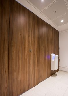 Alto full height flush fascia cubicles faced with walnut effect HPL