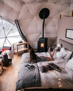 Geodesic dome glamping at its finest. The cozy interior of this dome, located in Switzerland's eco-luxury Whitepod Hotel, comes equipped with stylish furniture and a fireplace. This particular room is called the Deluxe Pod. Glamping, Design Hotel, House Design, Location Airbnb, Geodesic Dome Homes, Cozy Place, Cozy Bed, Home And Deco, Bed Styling
