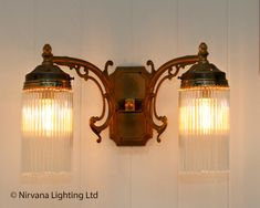 The reeded glass double wall light. Ornately detailed arms direct outwards at opposite angles. Ideal for a traditional theme. Single wall light version a...