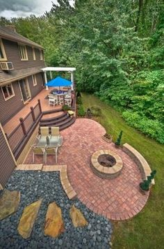circular patio with fire pit. similar to what i want but all one level and all pavers