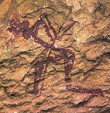 Pintura rupestre en Castellón (Comunidad Valenciana) España. Corresponde con el período de transición del Pañeolítico al Neolítico.Se cree que su representación está relacionada con prácticas de carácter mágico - religiosas para propiciar la caza.