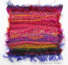 A fiber art quilt made of needle felted sari silk with hand beading by JoMo of peaceofpi studio.