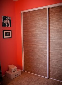 Great use of wallpaper to cover sliding mirror doors........clever.