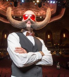 Beard contest: see many pics including the birdcage one made only out of his beard.