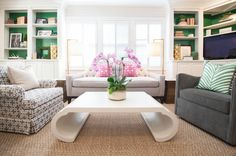 Lucy and Company - living rooms - gray velvet armchair, green and white zebra print pillow, sofa under window, built-in bookcases, built-in ...