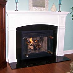 A gorgeous new Monarch Custom Fireplace Mantel looks great with these baby blue walls.