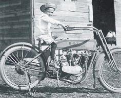 boy on 1915 twin Harley Davidson.