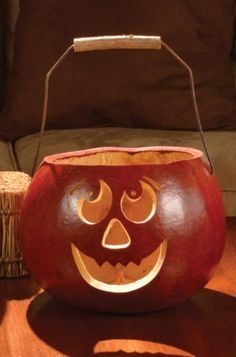 Great for trick-or-treating of filling with treats at home,the Large Basket is burnt orange in color with a wire and wood handle. Approximately 8� in diameter.