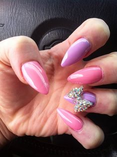 -- Pastel Pink and Purple stiletto nails with a bow! Just died, I totally want these!