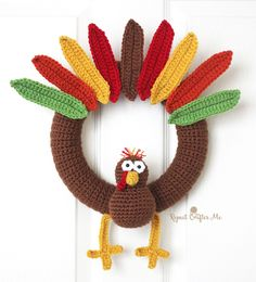 Celebrate Turkey Day with this fun Thanksgiving Wreath by Repeat Crafter Me! Make it with Vanna's Choice and a size G crochet hook.