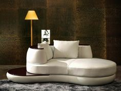 canape-d-angle-arrondi-en-cuir-beige-tapis-gris-meubles-de-salon-moquette-gris