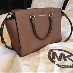 Michael Kors Large Selma in Camel Gorgeous large satchel in camel colored saffiano leather by Michael Kors. Features a zip closure, detachable strap, gold hardware, 1 interior zip pocket and 4 slip pockets. Comes with dust bag and in great condition. A few signs of wear: scratches on the bottom feet, a small mark on the front exterior left (can be seen in the first photo), a small light mark on the trim at the bottom (third pic) and a few light brown spots on the interior of the largest…