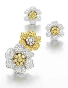 Pair of diamond earrings and brooch, Vacheron Constantin Each designed as a pair of flowers, pavé-set with brilliant-cut diamonds of yellow and near colourless tint, earrings with post and hinged back fittings, each with maker's marks for Vacheron Constantin, accompanied by pouches stamped Vacheron Constantin.