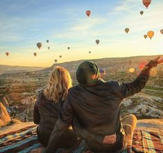 """""""Watching hundreds of hot air balloons fill the skies as the sun rose over Cappadocia was like being in fairy tale. We woke up at 5am from our cave guest house to get to the view point by sunrise. We jumped on our motorbike as balloons were floating above us. It was so cold outside that our bike wouldn't start and I was beginning to think we would miss it. It took Scott more than a dozen attempts to kick start our old rental bike and then we were off to join the hot air balloons rise above…"""