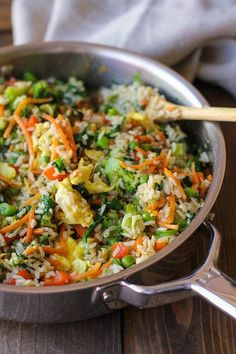 Fully-Loaded Vegetable Fried Rice with broccoli, carrot, bell pepper, spinach, and peas | TheRoastedRoot.net #healthy #recipe #vegetarian Make this vegan by using scrambled tofu in place of the eggs