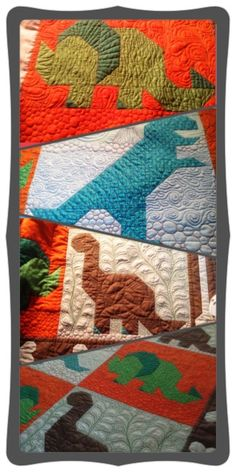 My mother in law made this for my nephew. I'm still amazed at the detail on this dinosaur quilt. So many different techniques used.