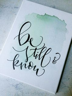 This is a beautiful, hand written calligraphy watercolor canvas sign with the inspirational message of be still and know. This sign features a lovely, light green watercolor background (with variation), free hand, modern calligraphy all on a 9x12 white canvas. Perfect for a gift or in your own home! Add some sweet inspiration to any room with this fun, simple sign!  Quick Details: hand written calligraphy be still & know light green watercolor background 9x12 white canvas  Have a question?…