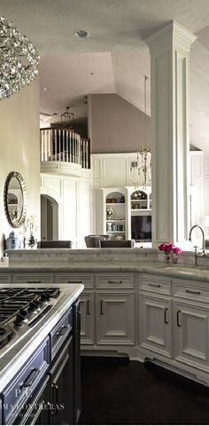 French Flair ● Kitchen. Cut out above base cabinets to living room. On another note... look at the awesome balcony.