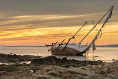 Shipwreck of a sailboat at Punta Del Este's harbour, during the sunset. Punta del Este, Maldonado, Uruguay.