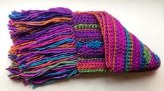 A personal favourite from my Etsy shop https://www.etsy.com/uk/listing/273848870/crocheted-scarf-bright-and-cheerful