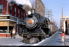 Strasburg Railroad (ex-Pennsylvania Railroad) #1223 'street-running' in Lancaster, PA with the 'Santa Clause Special', December 12, 1966