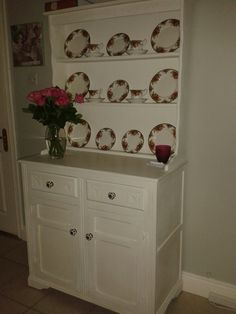 I bought this solid oak dresser at an auction. My sisters painted it for my Birthday and got me the beautiful china to go on it. It looks really great!