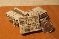Miniature Newspaper Bundles by Marquis Miniatures, via Flickr