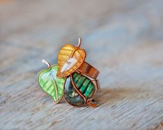 Hey, I found this really awesome Etsy listing at https://www.etsy.com/listing/184832484/adjustable-ring-green-golden-leaves