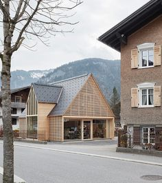 innauer matt adds pitched timber extension to gardening shop in austria