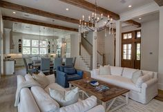 Similar layout to the dream house. Open entryway with stairs near the door, opens up into the great room.