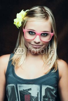 young girl with pink glasses