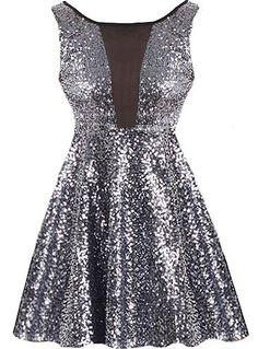 New Year's Kiss Dress: Features a cleverly designed bodice with sexy mesh paneling to the front and upper back, glittering charcoal sequin foundation, figure flattering empire waist, and a twirl-worthy A-line skirt to finish.