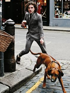 billy-george: Kit Harington killing it whilst in a double-breasted suit. Not sure how often I'd be walking a dog with a pint in hand. Photo via GQ