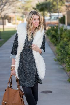 Fur vest, polka dot tunic, leggings and booties. Winter outfit from www.theredclosetdiary.com