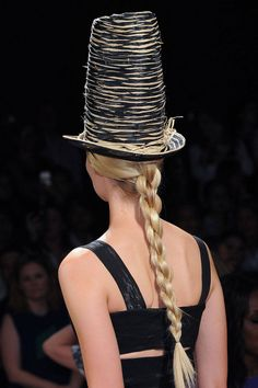 From twisted rope braids at Donna Karan (left) and cornrowed buns at Giorgio Armani to messy, classic plaits at Michael Kors, there's a braid for every skill level.   - HarpersBAZAAR.com