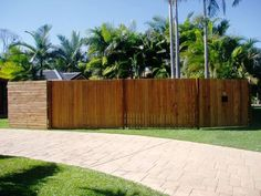 Paling Fence with Exposed Posts Oiled And Horizontal Pine Slat Gate