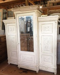 "Wonderful antique triple armoire just arrived! Carved details, original mirror, creamy distressed white, all shelves inside, 78"" wide, about 87"" tall. #perfect #ctpantiques #antique #armoire #shopdisplay #antiquestorage #distressedwhite #youneedthis"
