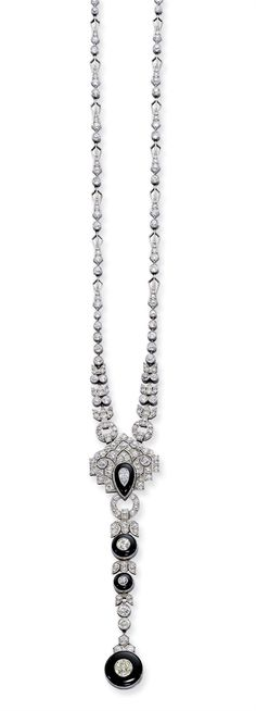AN ART DECO ONYX AND DIAMOND NECKLACE -  The central geometric diamond-set panel with pear-shaped onyx and diamond drop supporting three similarly-set circular motifs, to the graduated openwork diamond backchain, circa 1920