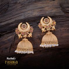 Rasika Jhumka earrings with synthetic ruby embellished floral design carved inside leaf with chandbali at top, plated with gold polish & made of pure 925 silver.