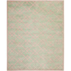 A contemporary design and dense, thick pile highlight this handmade rug inspired by Moroccan patterns with today's updated colors. This floor rug has a green background and displays stunning panel colors of ivory.
