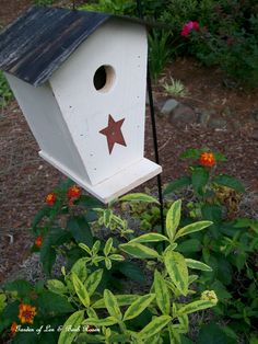 Birdhouse, lantana & variegated butterfly bush in the wheelbarrow.  (Garden of Len & Barb Rosen)  6/21/2012