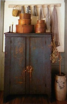 Love this cupboard & the pantry boxes on top....