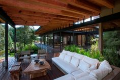 Forest house brings indoors out through glass walls, terraces | Modern House Designs