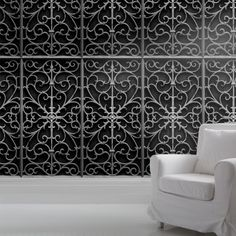The 'Wrought Metal Gate' wallpaper is inspired by wrought iron architectural details and gives the look of exquisitely ornate metal panels on the wall. It can be used to create a mysterious yet sophisticated feeling and is strangely reminicent of Moroccan screens, boudoirs and metal garden gates! Perfect for feature walls or a whole room.